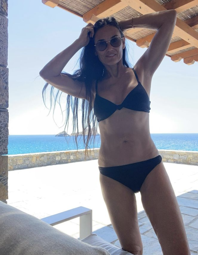 Demi Moore wearing a black bikini by Andie Swim during her summer holiday in Greece (Image via Instagram/DemiMoore).