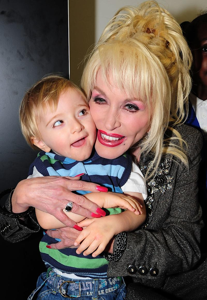 All the proceeds from Parton's new children's album will go to her children's literacy charity, Dolly Parton's Imagination Library.  (Pool via Getty Images)