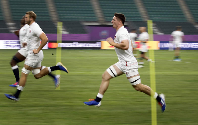 England's Tom Curry runs during a training session in Oita, Japan, Friday, Oct. 18, 2019. England will face Australia in the quarterfinals at the Rugby World Cup on Oct. 19. (AP Photo/Christophe Ena)