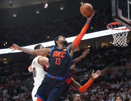 Apr 23, 2019; Portland, OR, USA; Oklahoma City Thunder forward Paul George (13) shoots over Portland Trail Blazers center Enes Kanter (00) in the second half of game five of the first round of the 2019 NBA Playoffs at Moda Center. Mandatory Credit: Jaime Valdez-USA TODAY Sports
