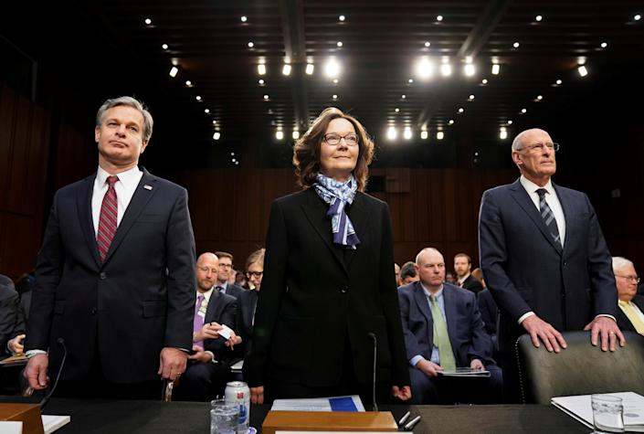 """From left: FBI Director Christopher Wray, CIA Director Gina Haspel and Director of National Intelligence Dan Coats arrive to testify Tuesday before a Senate Intelligence Committee hearing on """"worldwide threats."""" (Photo: Joshua Roberts/Reuters)"""