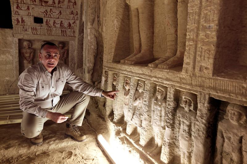 """Mostafa Waziri, secretary general of the Supreme Council of Antiquities, speaks inside a recently uncovered tomb of the Priest royal Purification during the reign of King Nefer Ir-Ka-Re, named """"Wahtye."""", at the site of the step pyramid of Saqqara, in Giza, Egypt."""