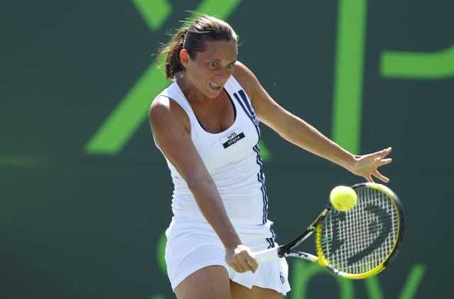 Roberta Vinci of Italy returns the ball to Serena Williams during the Sony Ericsson Open tennis tournament, Saturday, March 24, 2012, in Key Biscayne, Fla. (AP Photo/Lynne Sladky)