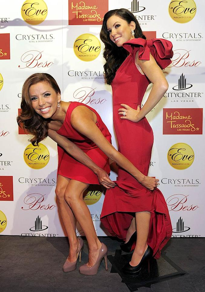 """Eva Longoria Parker playfully unveiled her lifelike wax figure at Eve Nightclub in Las Vegas Wednesday as part of National Hispanic Heritage Month. Though the """"Desperate Housewives"""" star wore a similar red gown, fittingly, the dress worn by her statue was the one Eva wore to the 2008 ALMA (American Latino Media Arts) Awards. Denise Truscello/<a href=""""http://www.wireimage.com"""" target=""""new"""">WireImage.com</a> - October 13, 2010"""
