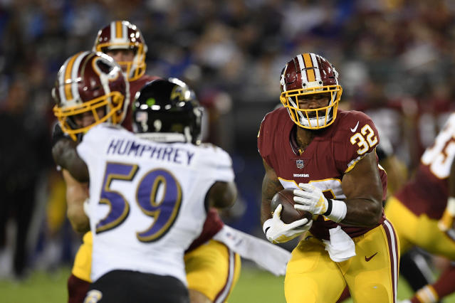 Washington Redskins running back Samaje Perine (32) rushes the ball in the first half of a preseason NFL football game against the Baltimore Ravens, Thursday, Aug. 30, 2018, in Baltimore. (AP Photo/Nick Wass)