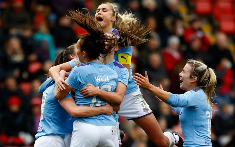 Jill Scott of Manchester City (obscured) celebrates with teammates after scoring her team's third goal during the Women's FA Cup Fourth Round match between Manchester United Women and Manchester City Women  - Morgan Harlow/Getty Image