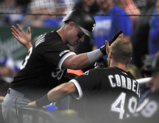 Chicago White Sox James McCann, left, is congratulated by teammates, including Ryan Cordell (49), after his solo home run during the sixth inning of a baseball game against the Kansas City Royals at Kauffman Stadium in Kansas City, Mo., Monday, July 15, 2019. (AP Photo/Orlin Wagner)