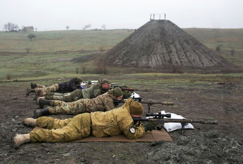 Snipers of the Ukrainian armed forces aim their rifles during training in Donetsk region