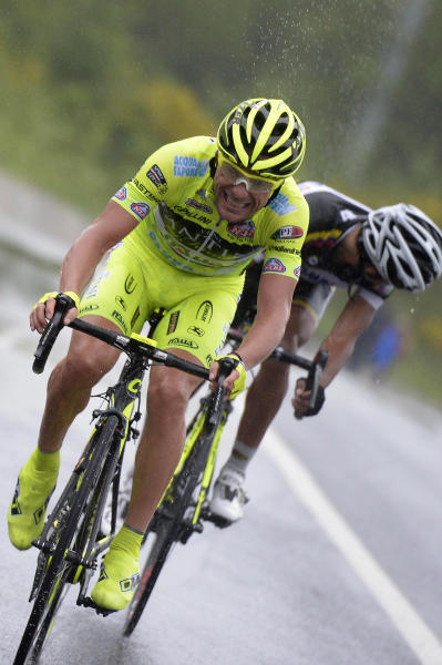 "FILE -- In this file photo, taken on May 7 2013, Italy's Danilo Di Luca, right, pedals during the fourth stage of the Giro d'Italia, from Policastro Bussentino to Serra San Bruno, Italy. Former Giro d'Italia winner Danilo Di Luca tested positive for EPO in a surprise test at his home before this year's race, organizers announced Friday, May 24, 2013. If confirmed in a backup ""B'' sample, Di Luca risks a lifetime ban since this is his third offense. The test was carried out April 29, five days before the Giro started. (AP Photo/Fabio Ferrari)"