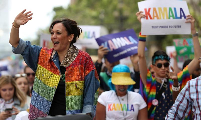 Kamala Harris waves to the crowd as she rides in a car during the San Francisco pride parade in California on 30 June.