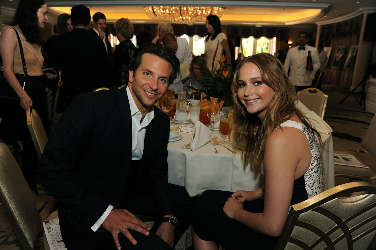 BEVERLY HILLS, CA - AUGUST 09:   (L-R) Actors Bradley Cooper and Jennifer Lawrence attend the Hollywood Foreign Press Association's 2012 Installation Luncheon held at the Beverly Hills Hotel on August 9, 2012 in Beverly Hills, California.  (Photo by Kevin Winter/Getty Images for HFPA)