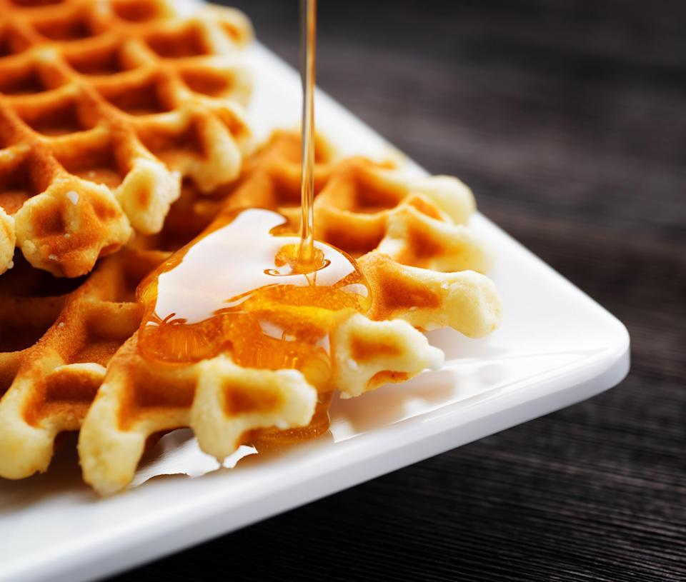 """<p>Two of <a href=""""https://www.thedailymeal.com/eat/iconic-american-breakfast-dishes?referrer=yahoo&category=beauty_food&include_utm=1&utm_medium=referral&utm_source=yahoo&utm_campaign=feed"""" rel=""""nofollow noopener"""" target=""""_blank"""" data-ylk=""""slk:the most iconic breakfast items"""" class=""""link rapid-noclick-resp"""">the most iconic breakfast items</a> in one? Yes, please. If you normally opt for chicken and waffles, then this twist is the dish for you. The kids can take turns stirring the batter.</p> <p><a href=""""https://www.thedailymeal.com/best-recipes/bacon-waffles?referrer=yahoo&category=beauty_food&include_utm=1&utm_medium=referral&utm_source=yahoo&utm_campaign=feed"""" rel=""""nofollow noopener"""" target=""""_blank"""" data-ylk=""""slk:For the Bacon Waffles recipe, click here."""" class=""""link rapid-noclick-resp"""">For the Bacon Waffles recipe, click here.</a></p>"""