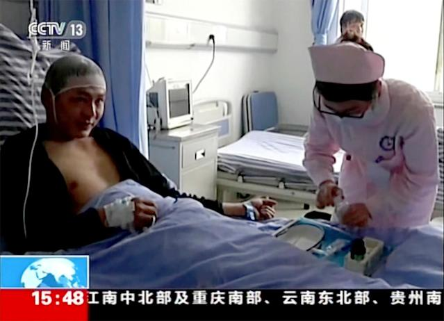 <p>Video still of Qiao Dashuai, left, is attended to by nurses at a hospital after surviving a landslide in Xinmo village in Maoxian County in southwestern China's Sichuan Province, Saturday, June 24, 2017. (Photo: CCTV via AP Video) </p>