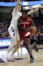 Nebraska forward Kevin Cross, right, drives against Northwestern center Ryan Young during the first half of an NCAA college basketball game in Evanston, Ill., Saturday, Jan. 11, 2020. (AP Photo/Nam Y. Huh)