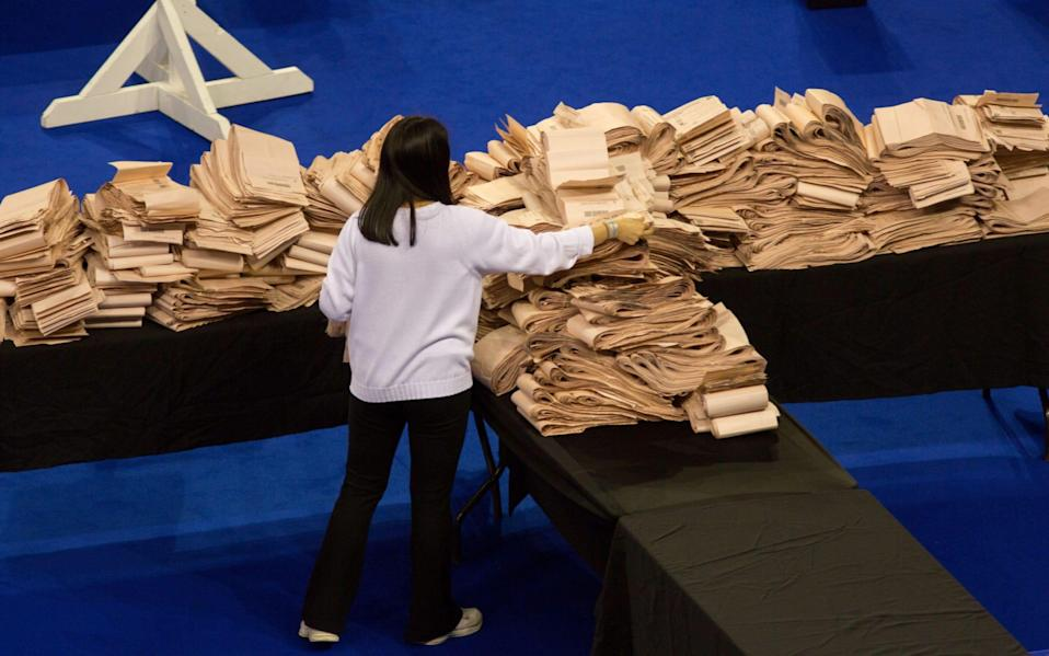 A staff member counts the votes of the Scottish elections at the Emirates in Glasgow - ROBERT PERRY/EPA-EFE/Shutterstock
