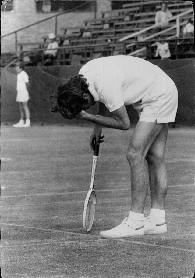 """<span class=""""element-image__caption"""">John Newcombe during a match against Charles Pasarell in the Dunlop Australian Open at White City</span> <span class=""""element-image__credit"""">Photograph: Fairfax Media Archives/Getty Images</span>"""