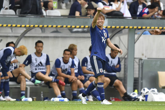 Japan's Takashi Inui celebrates after scoring during the friendly soccer match between Japan and Paraguay in the Tivoli Stadium in Innsbruck, Austria, on Tuesday, June 12, 2018. (AP Photo/Kerstin Joensson)