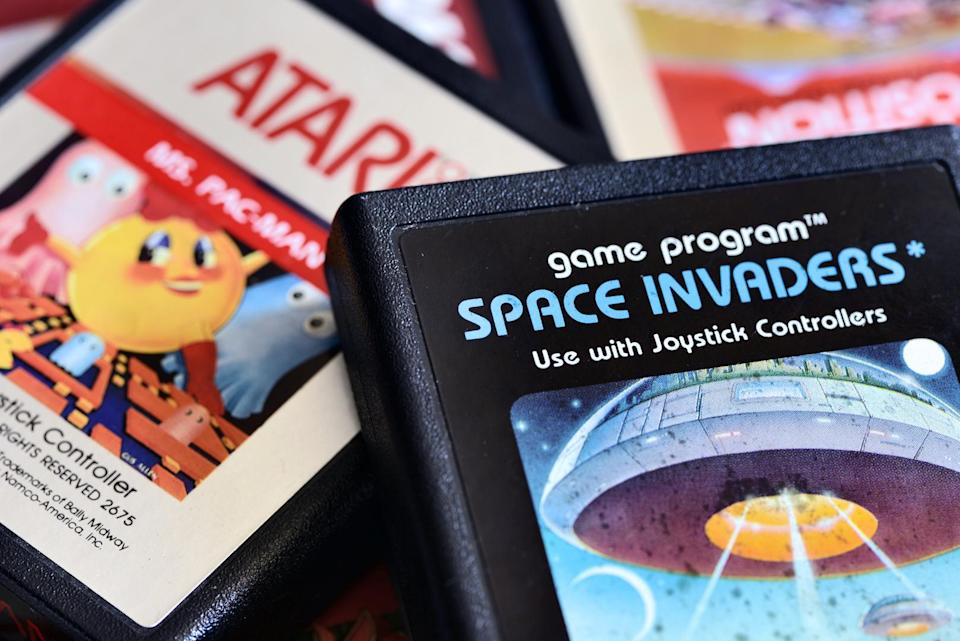 Varallo, Italy - December 6, 2013: Close up photography on vintage Atari 2600 video game cartridges including Space Invaders, Mrs Pac-Man, Pole Position and Kangaroo.