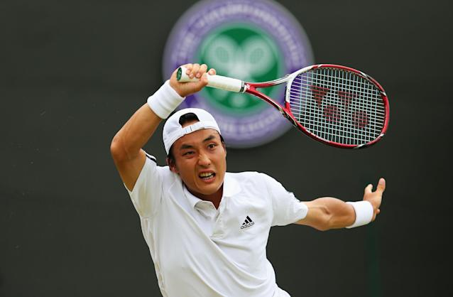 LONDON, ENGLAND - JUNE 27: Go Soeda of Japan plays a forehand during his Gentlemen's Singles second round match against Richard Gasquet of France on day four of the Wimbledon Lawn Tennis Championships at the All England Lawn Tennis and Croquet Club on June 27, 2013 in London, England. (Photo by Julian Finney/Getty Images)
