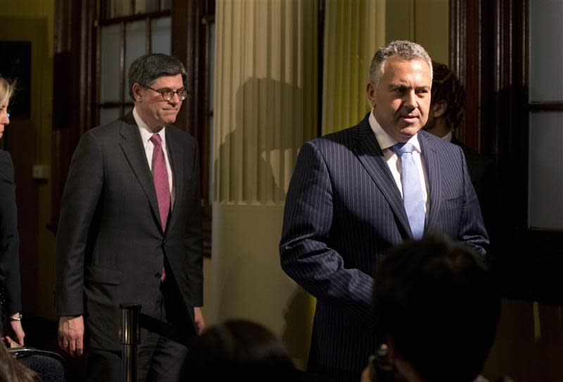 U.S. Treasury Secretary Lew and Australian Treasurer Hockey walk from a joint news conference at the G20 Finance Ministers meeting in Sydney