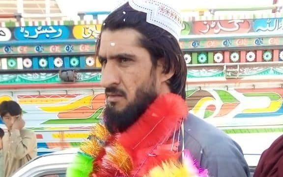 Taliban prisoner Sher Agha Muhammad Khan garlanded as he is greeted by relatives in Quetta