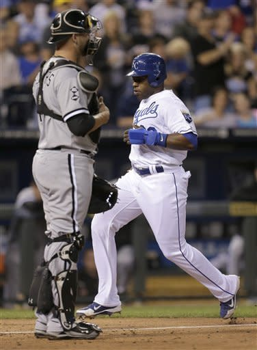 Kansas City Royals' Jason Bourgeois runs past Chicago White Sox catcher Tyler Flowers to score on a sacrifice fly by Billy Butler during the third inning of a baseball game Wednesday, Sept. 19, 2012, in Kansas City, Mo. (AP Photo/Charlie Riedel)