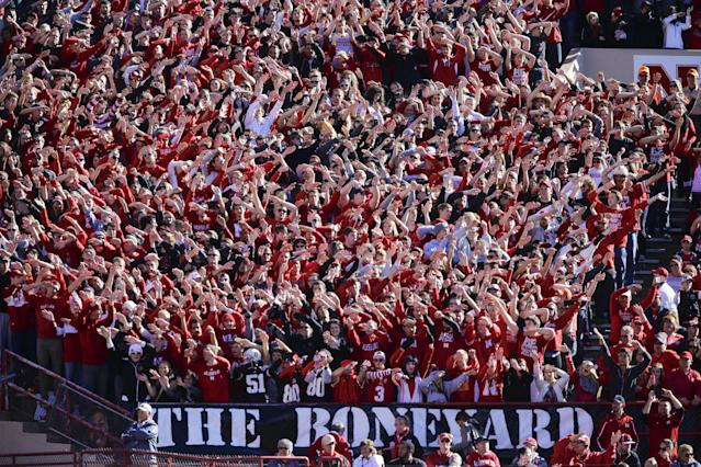 Nebraska fans wave their arms following a touchdown against Northwestern in the first half of an NCAA college football game in Lincoln, Neb., Saturday, Nov. 2, 2013. (AP Photo/Nati Harnik)