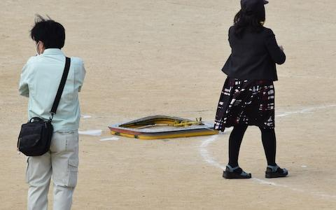 A window frame of US military aircraft fell into the playground of an elementary school in Ginowan - Credit: Kyodo News
