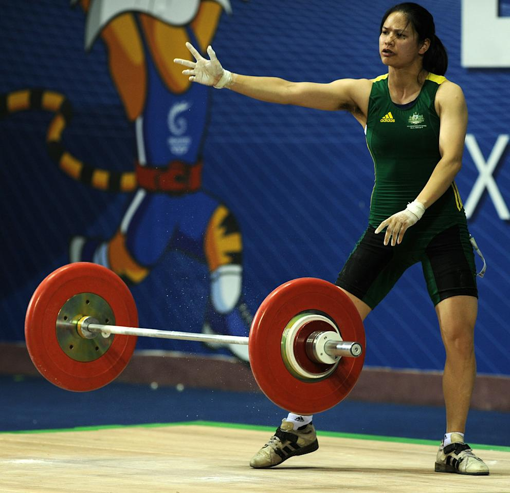 Australia's Seen Lee reacts after a successfull lift during the women's 58 kg weightlifting snatch event during the Commonwealth Games at Jawaharlal Nehru sports complex in New Delhi on October 6, 2010. The Indian capital is hosting the October 3-14 Commonwealth Games, the biggest sporting event in the city since the 1982 Asian Games. AFP PHOTO/ Manpreet ROMANA (Photo credit should read MANPREET ROMANA/AFP/Getty Images)
