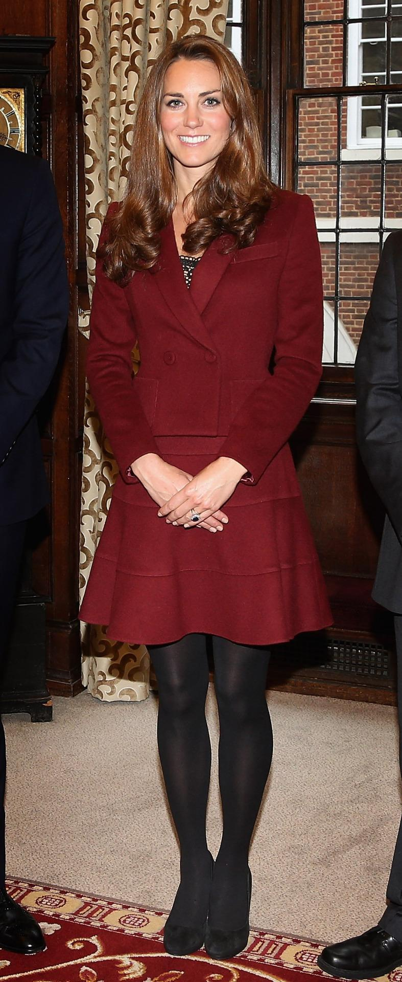 <p>The Duchess met law students in London in a burgundy jacket and skirt by Paule Ka. On her feet, she chose suede Episode heels. </p><p><i>[Photo: PA]</i></p>