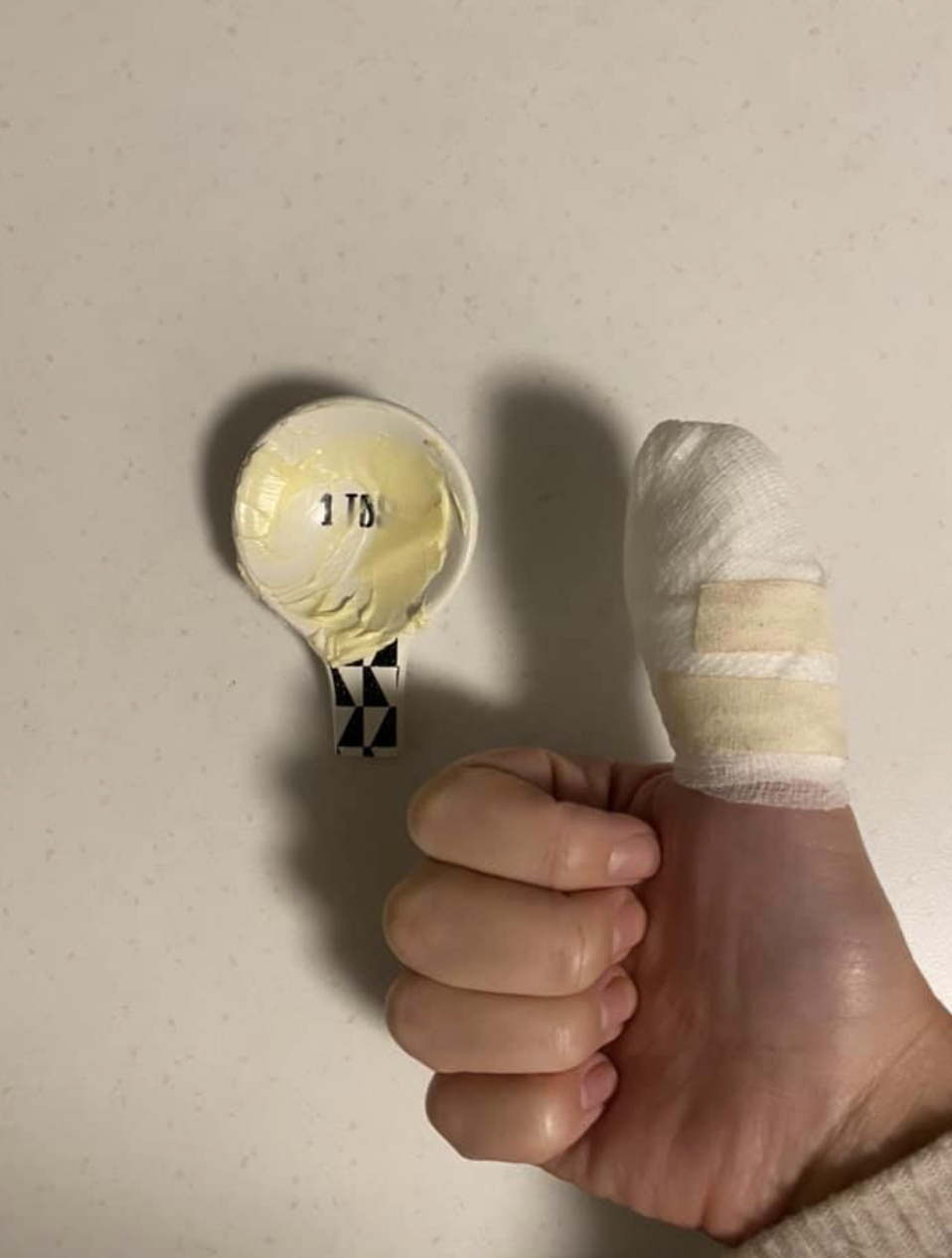 The mother said the Kmart measuring spoon left her with a deep cut in her thumb. Source: Facebook