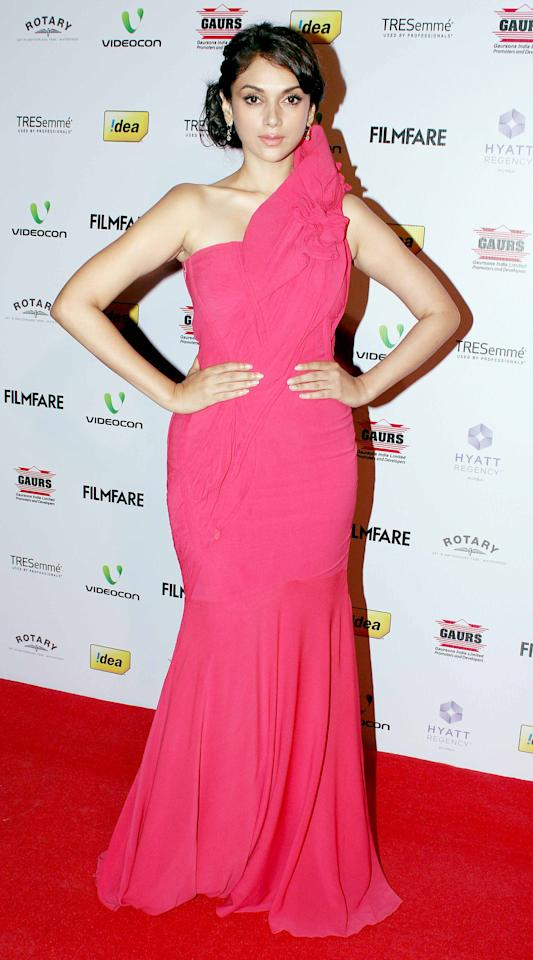 Actress Aditi Rao Hydri looks like a Disney princess in this pretty pink one shoulder gown.