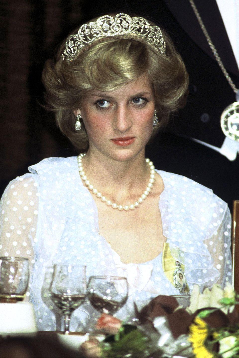 <p>With a more blown-out hairstyle and a diamond tiara at an event while visiting New Zealand. </p>