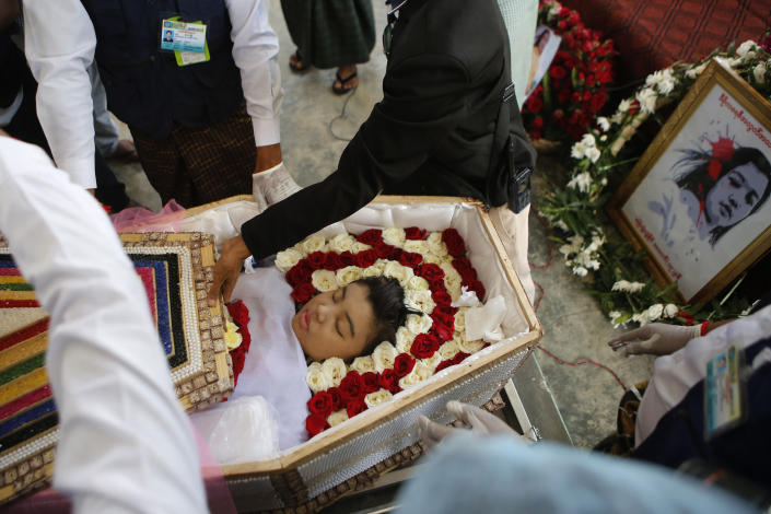 Mya Thwet Thwet Khine, lies in a coffin during her funeral in Naypyitaw, Myanmar, Sunday, Feb. 21 2021. Mya Thwet Thwet Khine was the first confirmed death among the many thousands who have taken to the streets to protest the Feb. 1 coup that toppled the elected government of Aung San Suu Kyi. The woman was shot on Feb. 9, two days before her 20th birthday, at a protest in the capital Nayptitaw, and died Friday. (AP Photo)