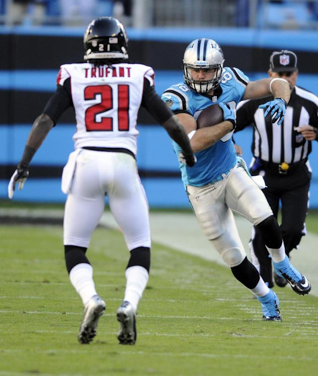 Carolina Panthers' Greg Olsen (88) runs after a catch as Atlanta Falcons' Desmond Trufant (21) defends in the second half of an NFL football game in Charlotte, N.C., Sunday, Nov. 3, 2013. (AP Photo/Mike McCarn)