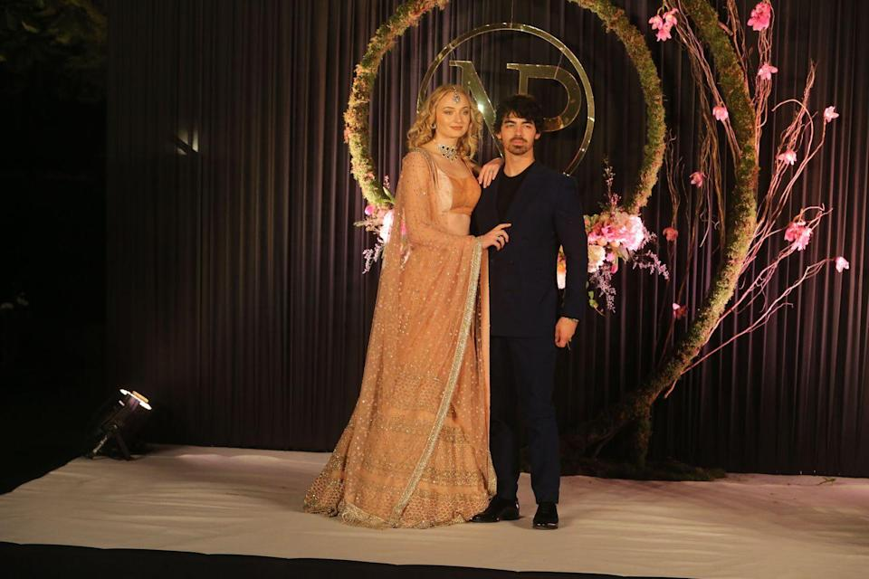 <p>Wearing traditional Indian dress, Sophie Turner wore an incredible embellished golden two piece and jewellery to the wedding reception of Priyanka Chopra and Nick Jonas in New Delhi. </p>