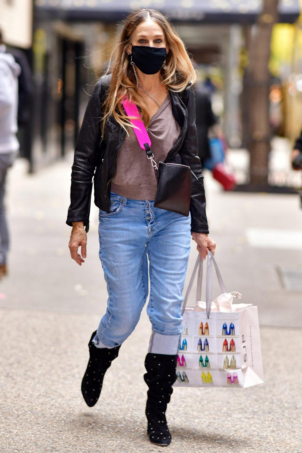 <p>Sarah Jessica Parker leaves her eponymous store with a goodie bag in tow on Tuesday in N.Y.C.</p>