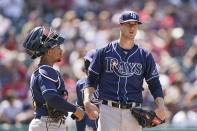 Tampa Bay Rays relief pitcher Matt Wisler talks with catcher Francisco Mejia after Wisler gave up a sacrifice fly to Bobby Bradley in the eighth inning of a baseball game, Sunday, July 25, 2021, in Cleveland. The Indians won 3-2. (AP Photo/Tony Dejak)