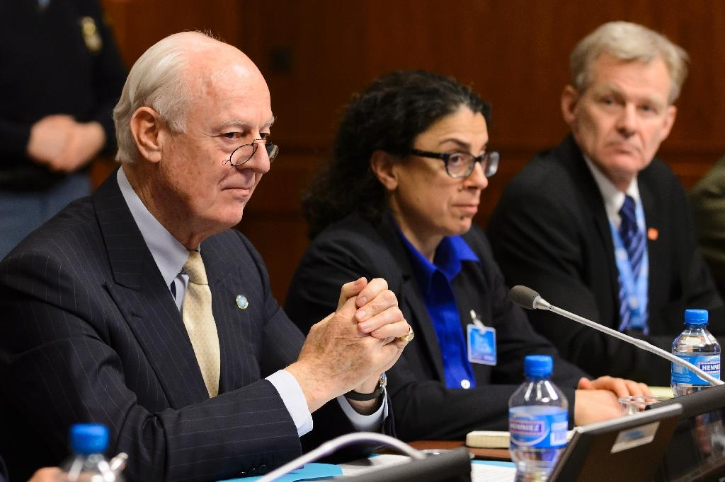 United Nations special envoy Staffan de Mistura (L) sits facing Syria's main opposition group during Syrian peace talks at the UN offices in Geneva on February 1, 2016