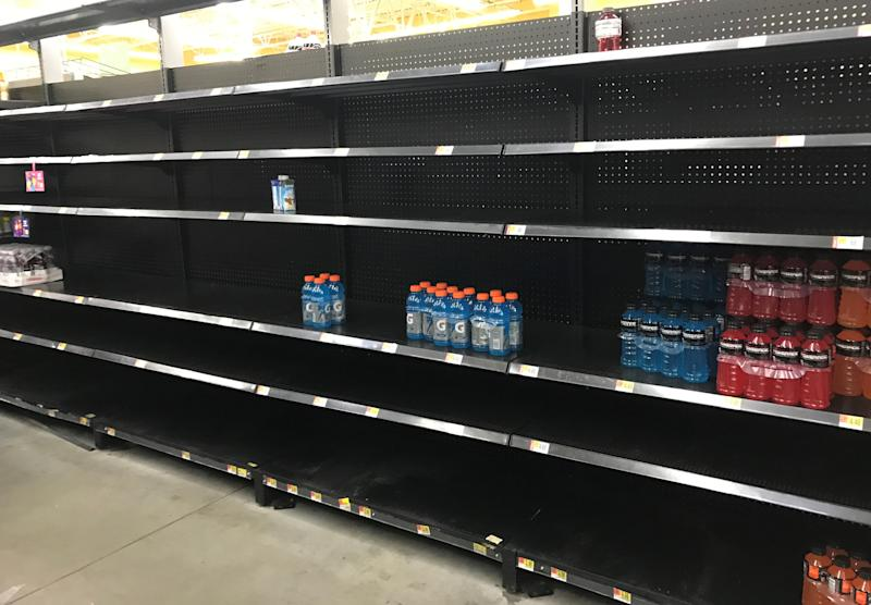 Store shelves in a Houston-area Walmart sit empty Friday, ahead of Hurricane Harvey. (Jim Tanner/Reuters)