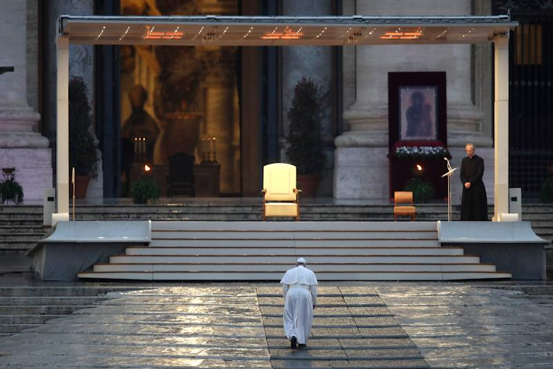 Pope Francis arrives to deliver an Urbi et orbi prayer from the empty St. Peter's Square, at the Vatican. March 27, 2020.