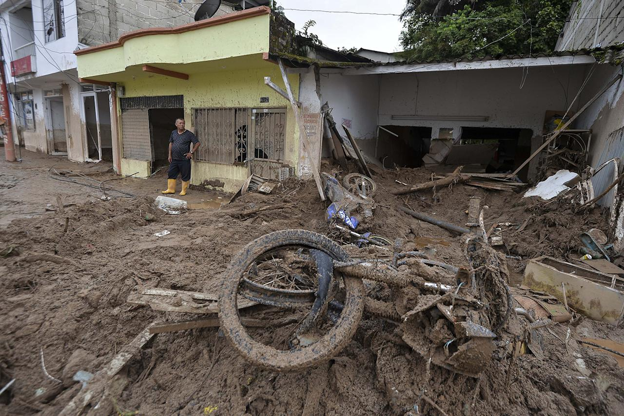 <p>A local stares at the rubble left by mudslides following heavy rains in Mocoa, Putumayo department, southern Colombia on April 2, 2017. (Luis Robayo/AFP/Getty Images) </p>