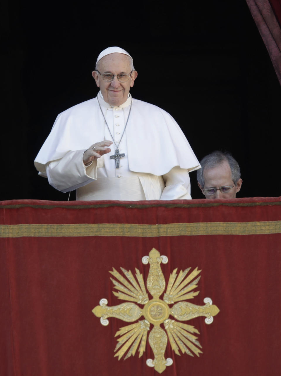 Pope Francis, flanked at right by Master of Ceremonies Bishop Guido Marini, arrives to deliver the Urbi et Orbi (Latin for 'to the city and to the world' ) Christmas' day blessing from the main balcony of St. Peter's Basilica at the Vatican, Tuesday, Dec. 25, 2018. (AP Photo/Alessandra Tarantino)