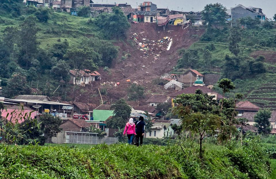 Landslides triggered by heavy rain in the village left at a number of people died and injured, officials said. Source: AP