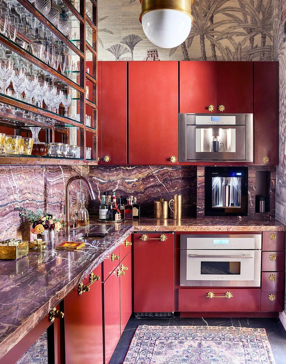 <p>When there's not much you can do with a cramped space without making it feel even smaller, add a rug. It'll warm it up, and add color and pattern without overwhelming your kitchen. Interior designer Michelle Nussbaumer also chose a warm color palette and packs plenty of texture-rich materials into the small space.</p>