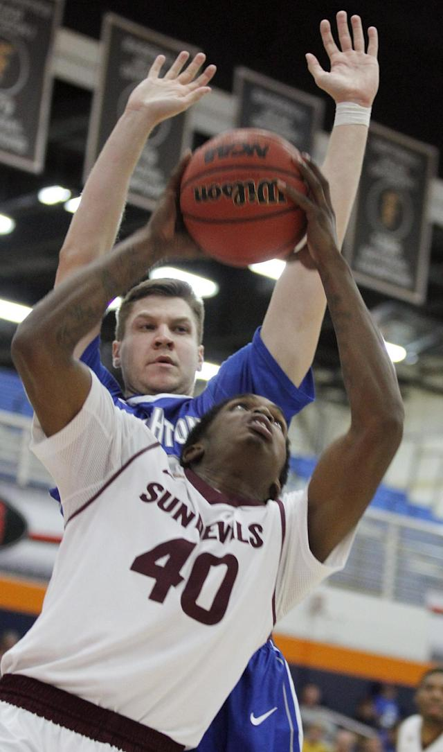 Arizona State forward Shaquielle McKissic (40) gets into position to shoot as Creighton guard Grant Gibbs defends during the first half of an NCAA college basketball game at the Wooden Legacy tournament Thursday, Nov. 28, 2013, in Fullerton, Calif. (AP Photo/Alex Gallardo)