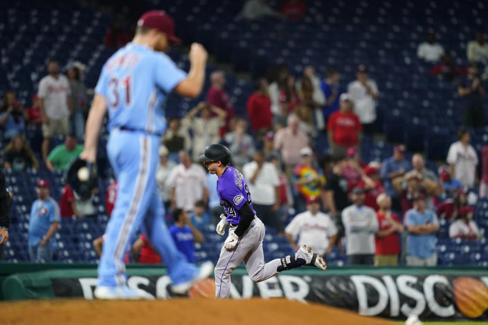 Colorado Rockies' Ryan McMahon, right, rounds the bases after hitting a two-run home run against Philadelphia Phillies pitcher Ian Kennedy during the ninth inning of a baseball game, Thursday, Sept. 9, 2021, in Philadelphia. (AP Photo/Matt Slocum)