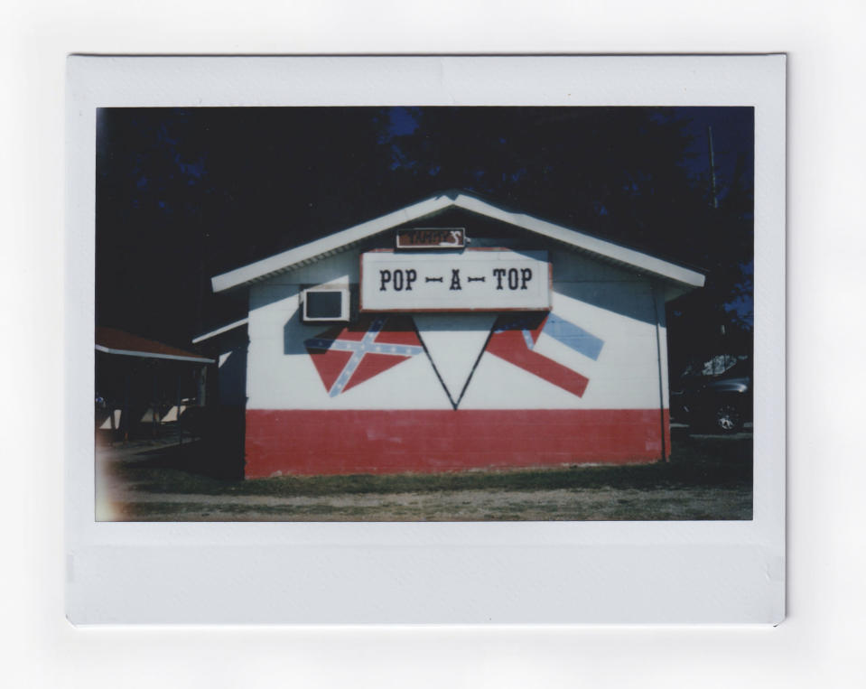 The facade of a bar is decorated with a Confederate flag in Meridian, Miss., Wednesday, Oct. 7, 2020. Voters in Mississippi face a series of government-created barriers that make it, according to a study in the Election Law Journal in 2018, far and away the most difficult state in which to vote. (AP Photo/Wong Maye-E)
