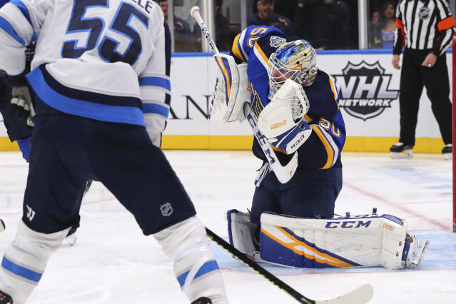 St. Louis Blues goalie Jordan Binnington (50) makes a save against the Winnipeg Jets during the third period of an NHL hockey game Sunday, Dec. 29, 2019, in St. Louis. (AP Photo/Dilip Vishwanat)