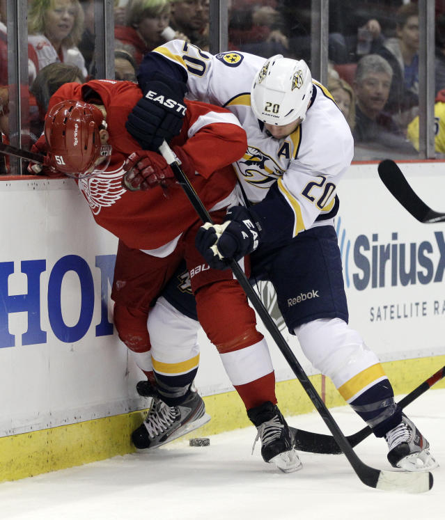 Detroit Red Wings center Valtteri Filppula (51), of Finland, and Nashville Predators defenseman Ryan Suter (20) battle for the puck during the first period of Game 3 of an NHL hockey Stanley Cup first-round playoff series in Detroit, Sunday, April 15, 2012. (AP Photo/Carlos Osorio)